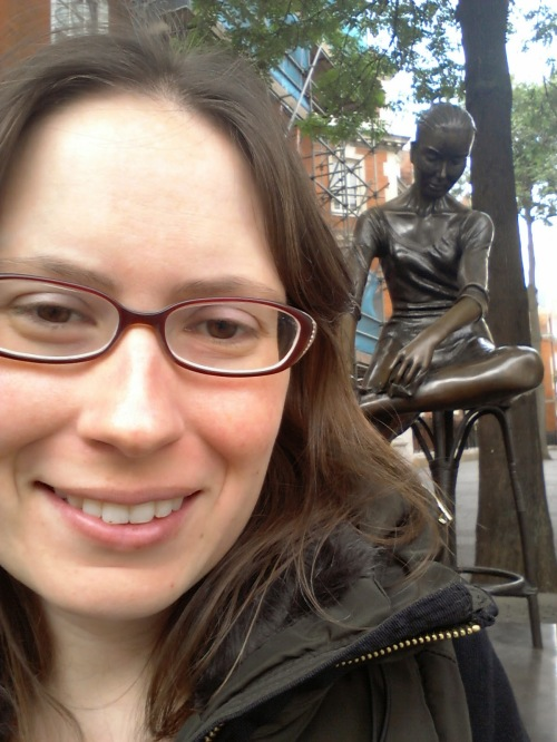 Me in London last summer, with my favorite statue, which inspired one of the characters in my book.